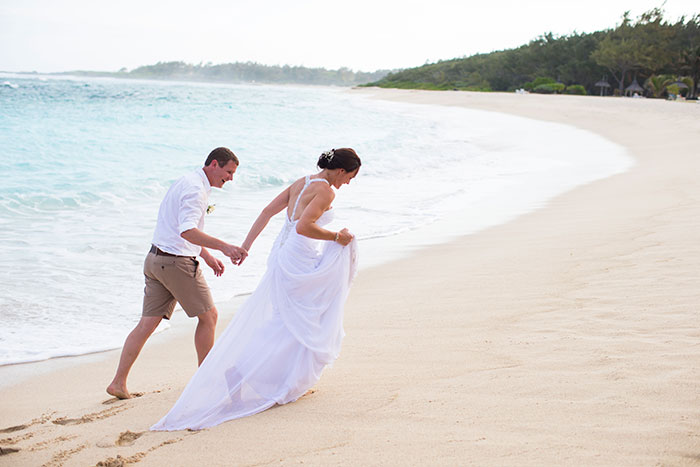 bride groom  walk on the beach