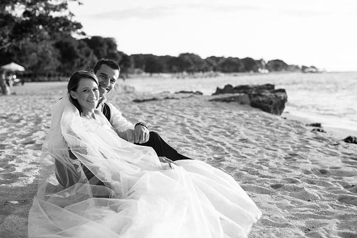Bride and groom portrait beach